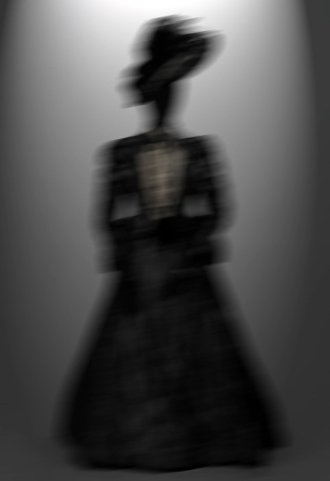 blurred silhouette of lady in black
