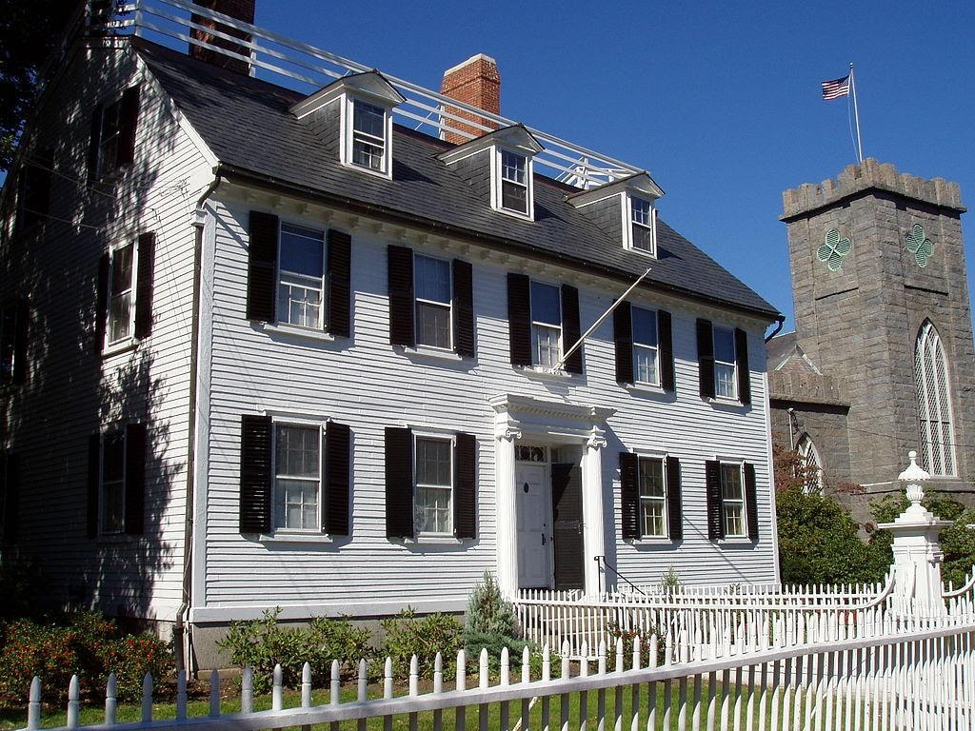The picturesque white weatherboard exterior of the Ropes Mansion, Salem, MA