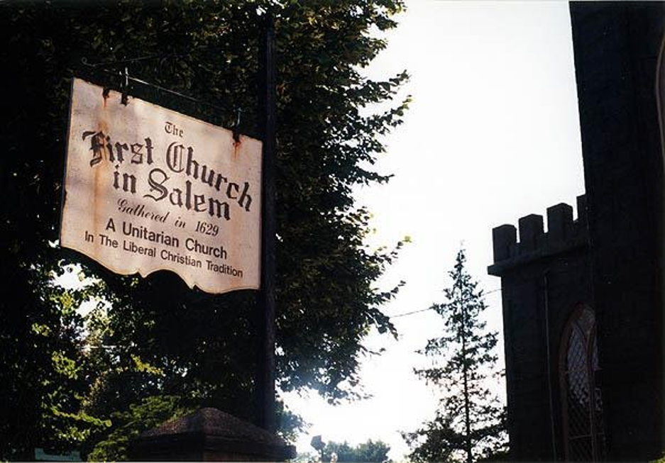A sign that reads the first church in salem