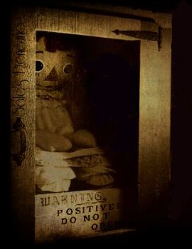 Annabelle in a glass cabinet with warning sign