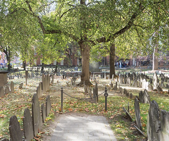 photo shows a large tree and tombstones in the Granary Park Burial Grounds.