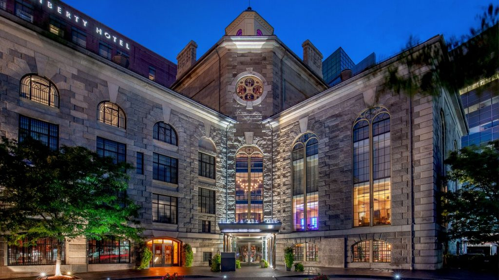 photo shows the stunning exterior of The Liberty luxury hotel, with colorful stained glass windows.