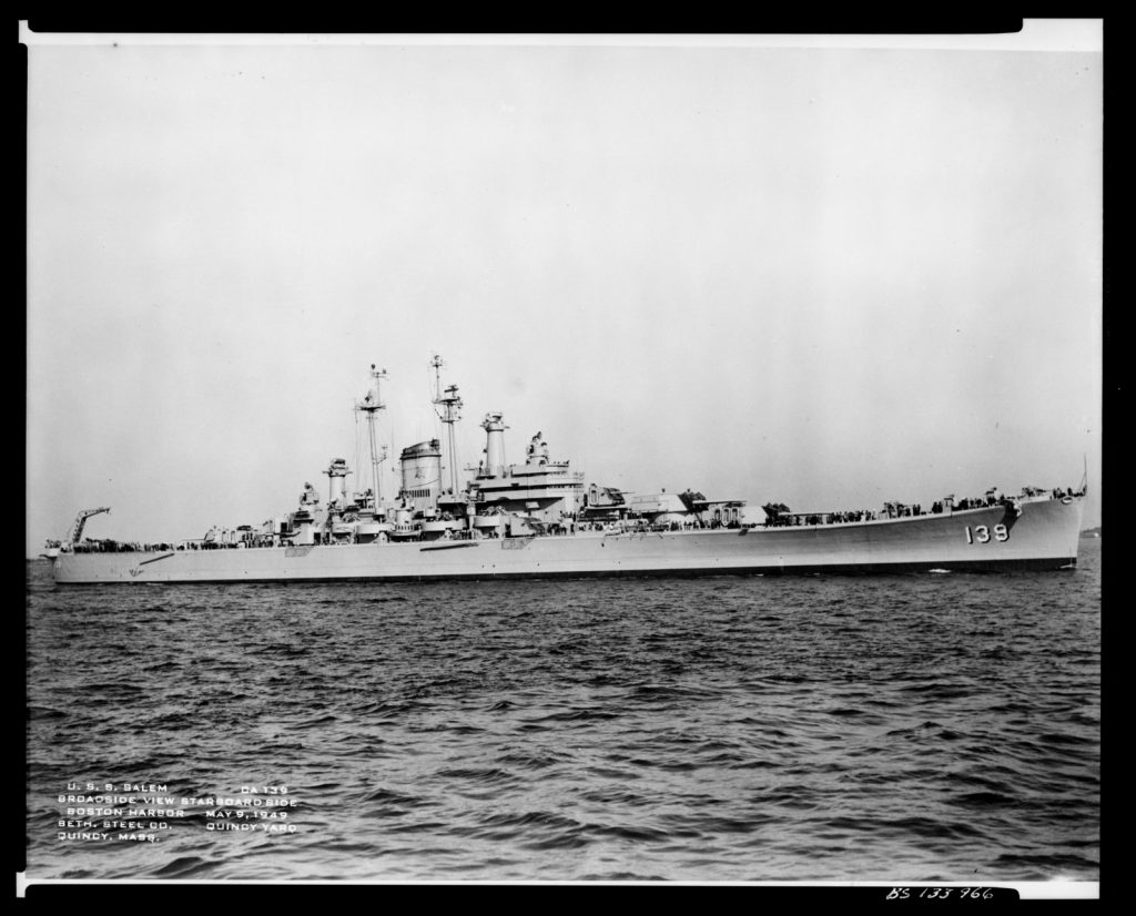 old photo showing the USS Salem ship sitting out on open water