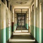 photo shows a corridor of an abandoned hospital