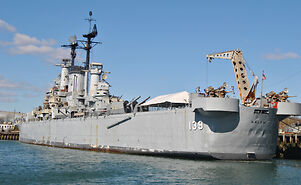 photo shows the USS Salem in the water at a dock