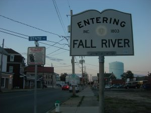 """photo shows the sign for Fall River, which reads 'entering fall river, established 1803."""""""